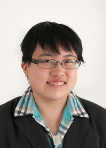 Headshot of young east asian person, Lydia Brown, in professional clothes and Allah pendant.
